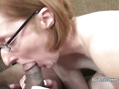Mature Layla in a short skirt and sucking a cock