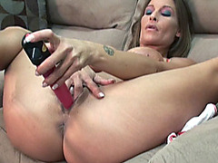 Petite and busty housewife Leeanna Heart is using a pink vibrator to fuck her wet pussy