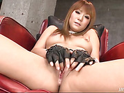 Cosplay honey Kokoa Ayane in her play gear fingers her shaved pink pussy