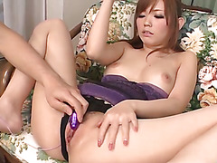 Megu Kamijyou at home with her fuck buddy and a purple mini vib playing and having a good time