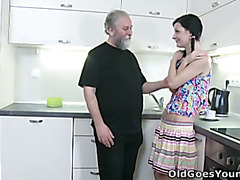 Karina kneels before both of her men and takes their cum all over her mouth and tits.