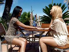 Beautifull teen brunette and blonde lesbians sharing a glass of wine outdoor and carressing
