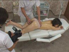 Shy topless Japanese schoolgirl has erotic massage