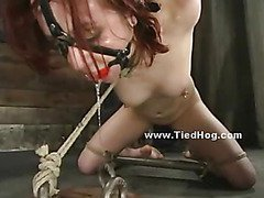 Redhead babe in short dress naked and tied like a hog subdued in bondage rough spanking submits