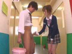 Naughty Japan teen schoolgirl gives handjob in hallway