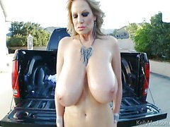 Busty MILF Oils Up Her Spectacular Tits Outdoors