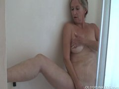 Gorgeous granny has a steamy shower