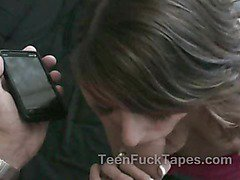 Teen babe multitasking on phone while giving head
