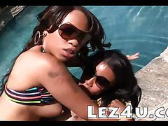 Two ebony lesbians with great boobies poolside pussy play