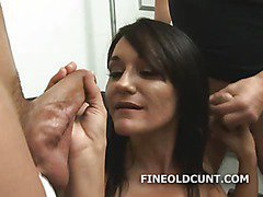 Sexy milf with two dudes sucking their cocks