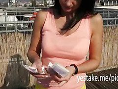 Brunette sucks and gets fucked for cash on top of a building