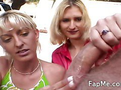 Two blondes pleasing a big fat cock