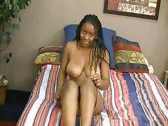 Busty black girl sucks hard white cock