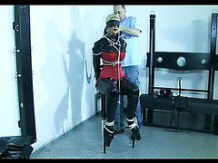 Hot slave girl gets tied up on a chair