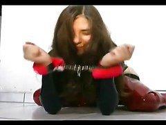Slutty slave girl poses on the floor
