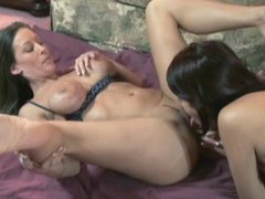 Lesbo Leeanna munching pussy with a busty slut