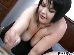 Heavy tattoed girl handles a cock