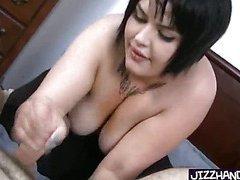 Heavy tattoed girl handles a cock