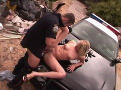 Lusty blonde dropout seduces and fucks a cop on a police car