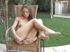 Brunette Spreads Her Pussy Lips And Fucks Herself