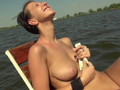 Busty amateur strips off her bikini and fucked on her boat