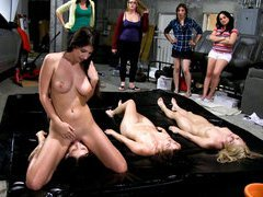 Coed lesbians oiled up for naked wrestling and face sitting